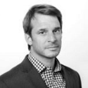 Black and white portrait of Andrew Becker, member of NCDJ Advisory Board.