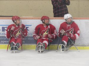 The Coyotes Sled Hockey defensive players waiting to rotate into the game.