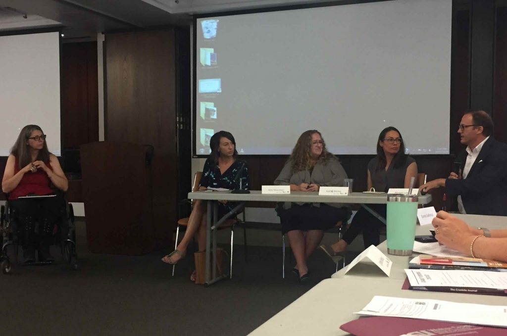 Local reporters sit together behind a large table speaking towards the workshop participants. Panelists include including Maria Polletta, Amy Silverman, Kathy Ritchie and Morgan Loew.