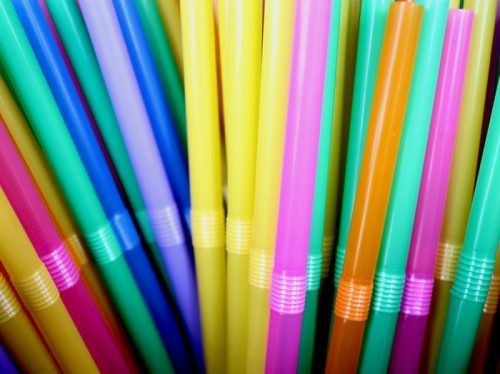 Tight cluster of brightly colored straws