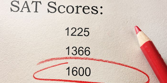 A stock photo of SAT test scores. A score of 1600 is circled in red colored pencil.