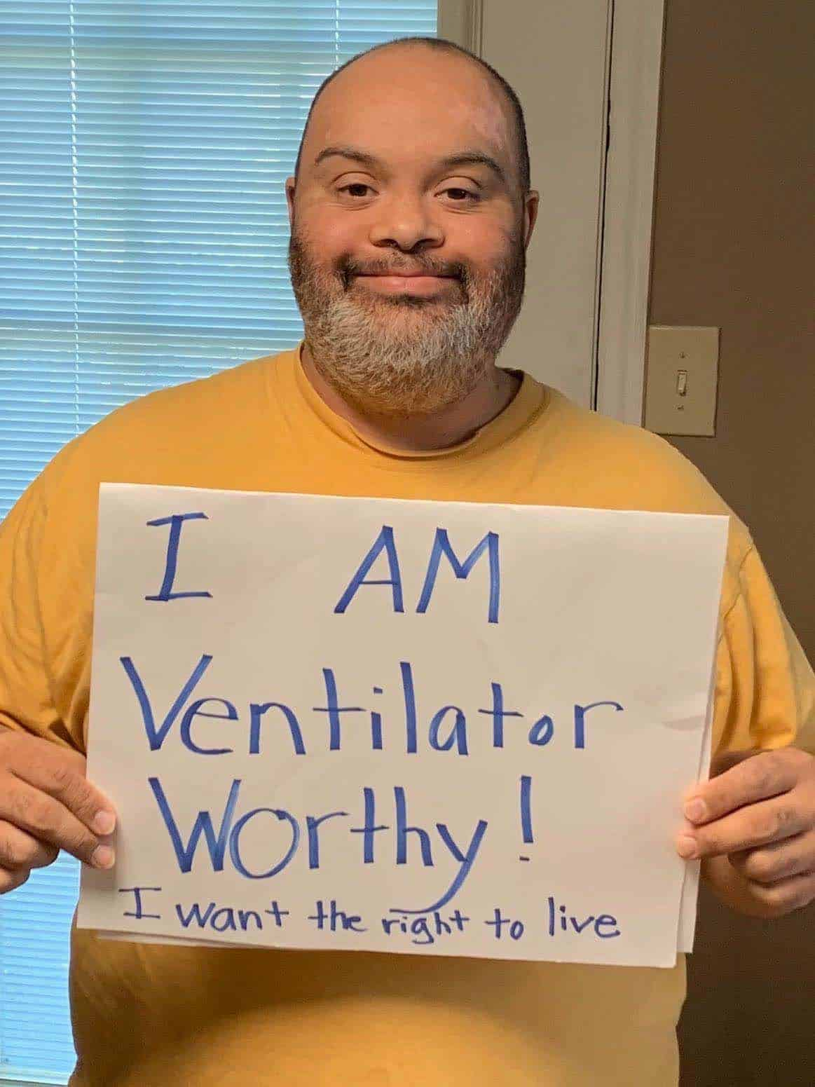 "Vestavia Hills, Alabama, resident Matthew Foster, who has Down syndrome, holds a sign reading: ""I am ventilator worthy! I want the right to live"""